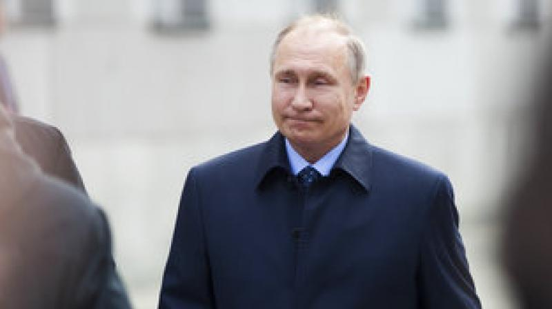 Polling at around 70 per cent, the macho leader is sure to extend his term to 2024 despite a lacklustre campaign ahead of a summer when global attention will be glued to Russia as it hosts the football World Cup. (Photo: AP)