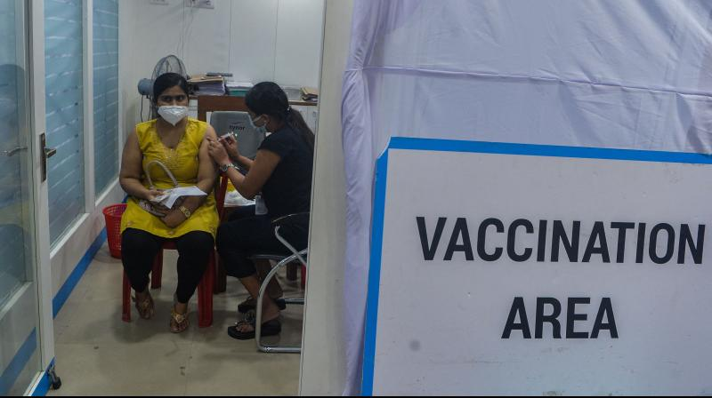 A health worker inoculates a woman with the jab of Covishield vaccine against the Covid-19 coronavirus at a branch of State Bank of India in Siliguri. (Photo: AFP)