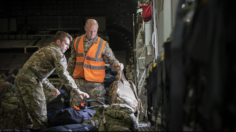 Mmilitary personnel work onboard the C-17 aircraft after landing at RAF Brize Norton, in Oxfordshire, England, Sunday, Aug. 29, 2021. (Photo: AP)