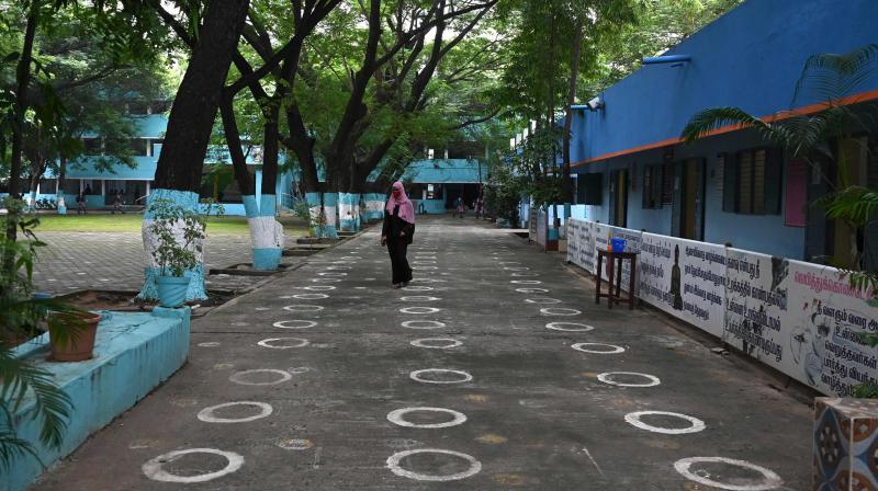 A student arrives to attend classes at a school in Chennai on September 1, 2021, after the state government relaxed the Covid-19 coronavirus lockdown norms for educational institutions, allowing students to attend physical classes. (Photo: AFP)