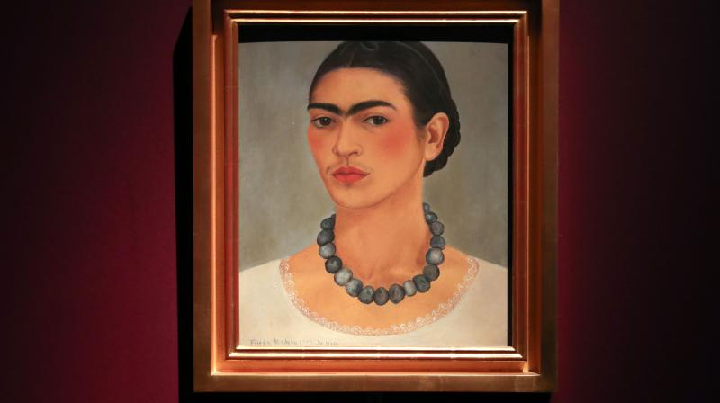 An artwork entitled 'Self-portrait with Necklace', by Frida Kahlo, 1933, Detroit and New York, USA, is displayed during an exhibition entitled 'Frida Kahlo: Making Her Self Up' at the Victoria and Albert (V&A) Museum in west London on June 13, 2018.(Photo: AFP)