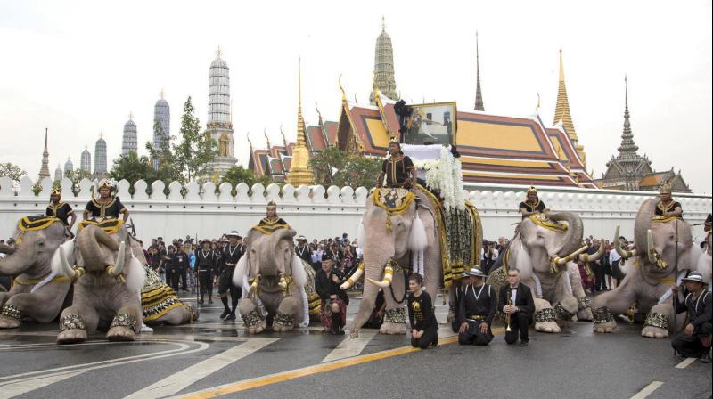 Mahouts lead 11 white elephants to kneel in front of the Grand Palace in honour of Thailand's King Bhumibol Adulyadej in Bangkok, Thailand on November 8. (Photo: AP)