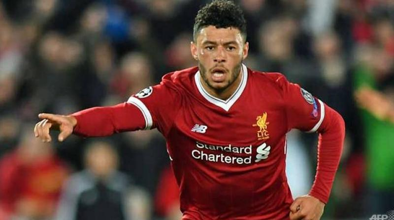 Midfielder Alex Oxlade-Chamberlain has signed a new long-term contract at Liverpool, the Premier League club have said. (Photo:AFP)