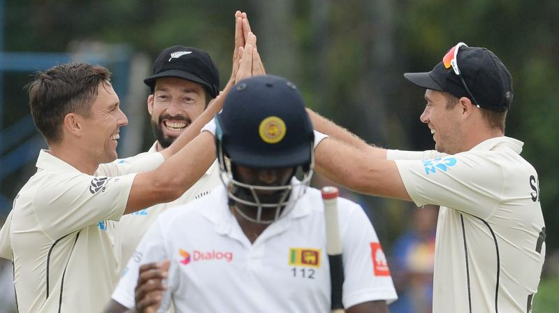 Trent Boult and Tim Southee ran through Sri Lanka's batting order to restrict Sri Lanka to 144/6. (Photo:AFP)