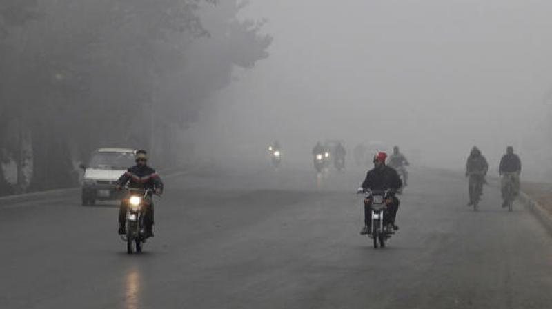 The thick fog making the visibility very low has lead to disruption of rail, road and air services. (Photo: AP)