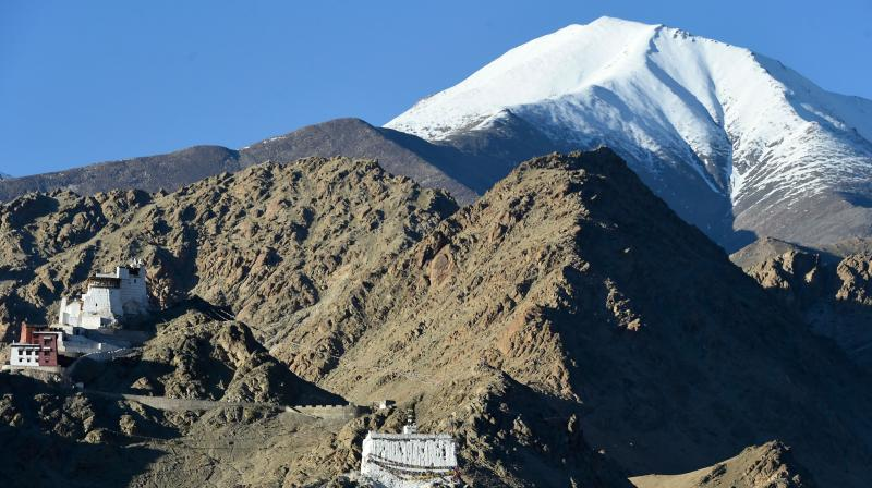 Houses are seen on the mountain in Leh, the joint capital of the union territory of Ladakh. PTI photo