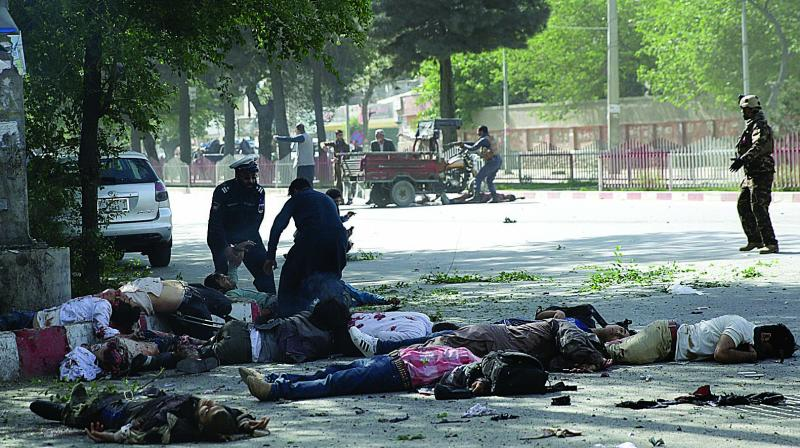 Victims in double explosions lie on the ground in Kabul, Afghanistan. (Photo: AP)