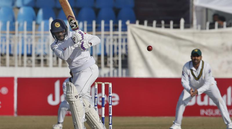 Middle-order batsman Dhananjaya de Silva completed his century on the fifth and final day against Pakistan in Rawalpindi on Sunday, first Test in the country since 2009 shooting. (Photo:AP)