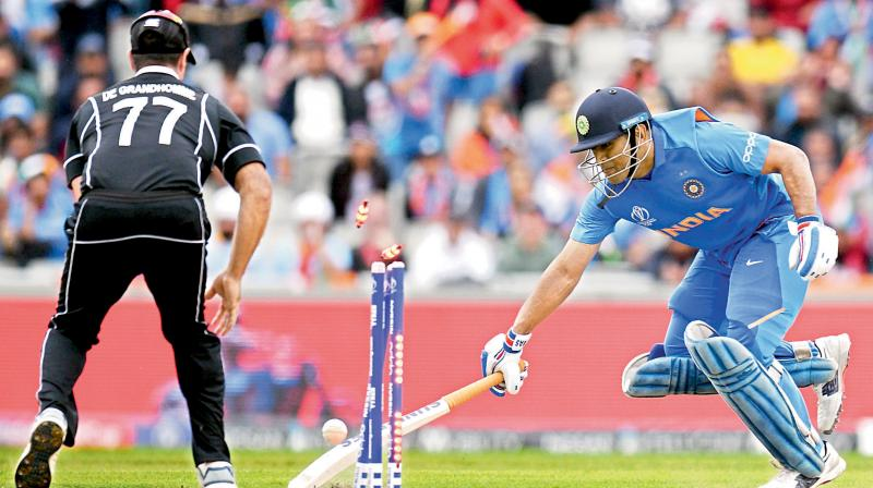 On Friday (December 13, 2019), team India's head coach, Ravi Shastri finally disclosed the actual reason why Mahendra Singh Dhoni batted at number 7 during India's ICC Cricket World Cup 2019 semi-final defeat to New Zealand.  After India's defeat, many eyebrows were raised as to why Dhoni was sent at 7, despite losing five early wickets. (Photo:AFP)