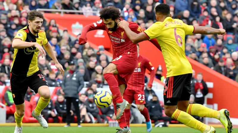 Liverpool forward Mohamed Salah kept up his scoring streak against Watford with a brace as the Premier League leaders sealed a 2-0 victory over the bottom club at Anfield on Saturday.  (Photo:AFP)