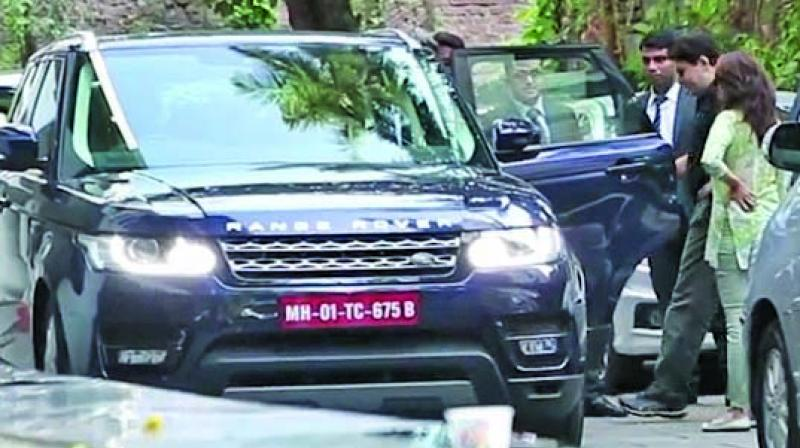 Madhuri spotted with husband Shriram Nene checking out the car
