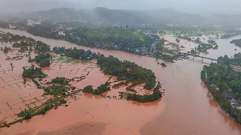 43 roads have been submerged and a bridge on the Vashisthi river was damaged at Chiplun due to heavy floods. (PTI Photo)