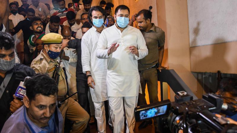 RJD leaders Tejashwi Yadav and Tej Pratap Yadav leave after the grand alliance press conference ahead of the Bihar Assembly Elections, in Patna. PTI Photo