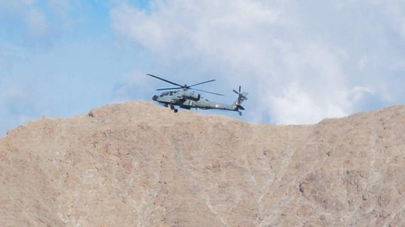 An IAF chopper flies in the skies of Leh in Ladakh. PTI photo