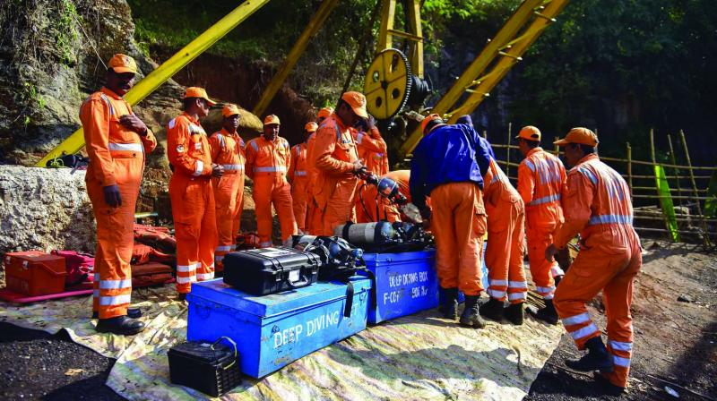 NDRF personnel conduct rescue operations at the site of a coal mine collapse in the Jaintia Hills district of Meghalaya. (Photo: PTI)