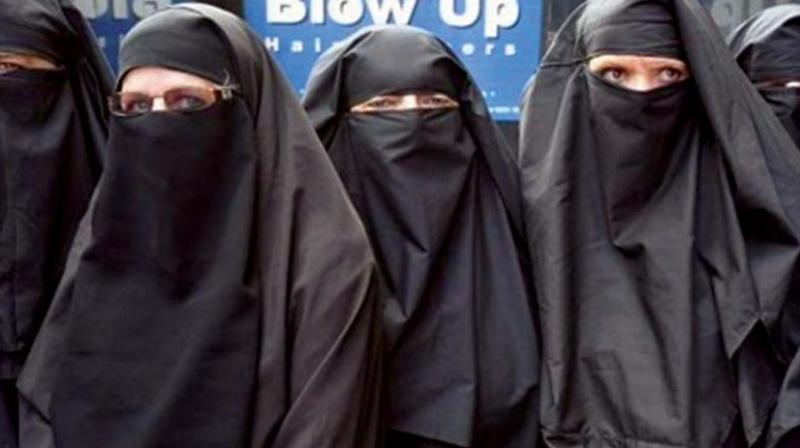 The issue of women wearing a face-cover, a burqa, in public is different from wearing hijab or head-cover to keep private a woman's attractive hair.