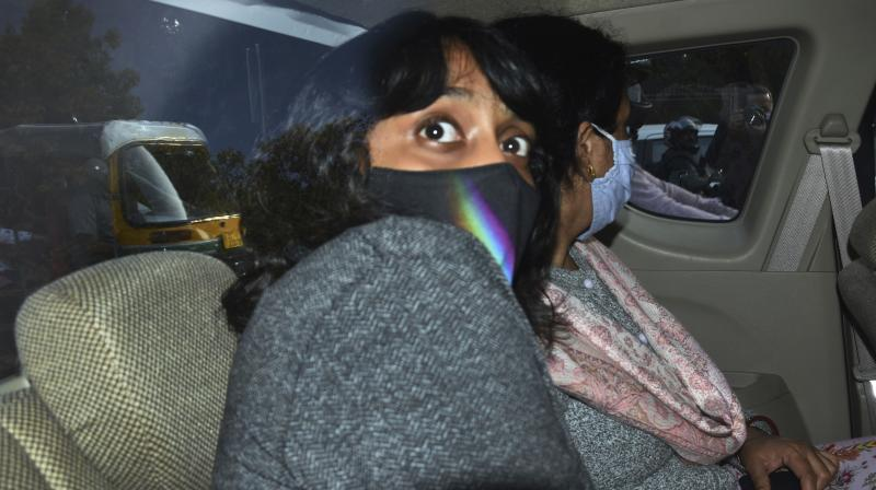Climate activist Disha Ravi, 22, being taken to a court in New Delhi, India, Monday, Feb. 22, 2021. Ravi was arrested for circulating a document on social media supporting months of massive protests by farmers in India. (AP)