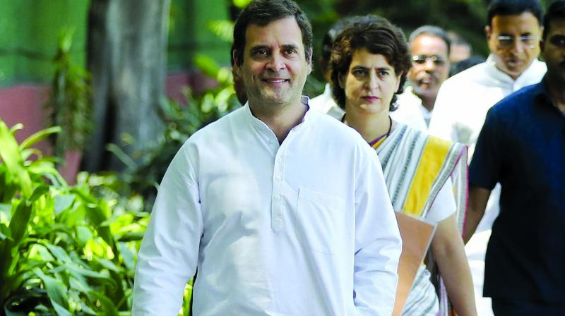 Congress chief Rahul Gandhi and his sister, Priyanka Gandhi Vadra, arrive for the Congress Working Committee meeting in New Delhi on Saturday. (Photo: AP)