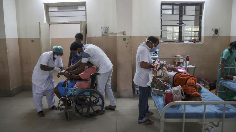 Health workers attend to patients infected with black fungus at the Mucormycosis ward of a government hospital in Hyderabad, May 23, 2021. (AP /Mahesh Kumar A.)