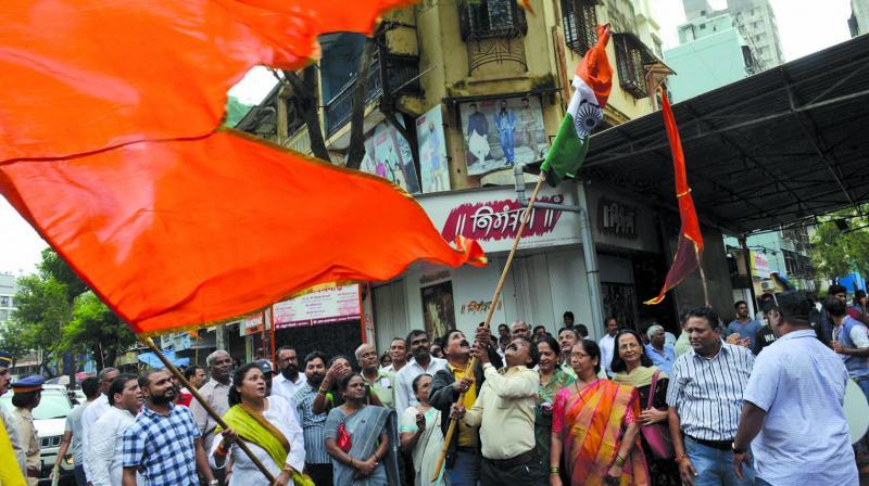 Sena workers celebrate on Monday. (Photo: RAJESH JADHAV)