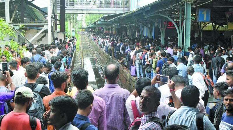 Commuters throng Thane station on Monday morning after Central Railway services had finally resumed. (Photo: DEEPAK KURKUNDE)