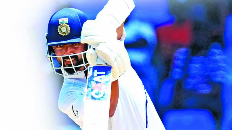 Ajinkya Rahane made a crucial 81 on the  opening day to help India recover from a poor start. (Photo: AFP)