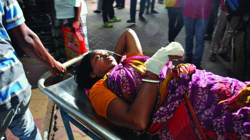 Injured Kaushi Mondal being treated at Calcutta National Medical College & Hospital after a wall collapse in Kachua triggered a stampede like situation in North 24 Parganas district on Friday. (Photo: PTI)