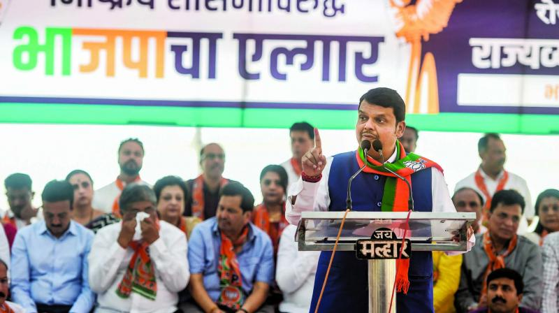 Former Maharashtra chief minister Devendra Fadnavis addresses BJP party workers during a protest rally against the state government at Azad Maidan in Mumbai on Tuesday. (Photo: PTI)