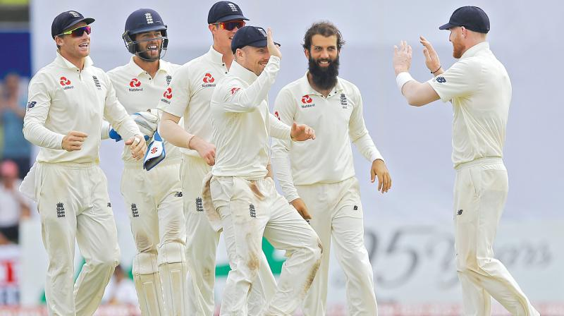 England players celebrate a Sri Lankan wicket in the first Test. (Photo: AP)