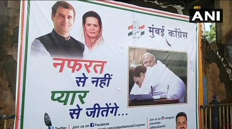The posters, put by the Congress workers, have a tagline that reads: 'Nafrat se nahi, Pyar se jeetenge.' (Photo: Twitter | ANI)