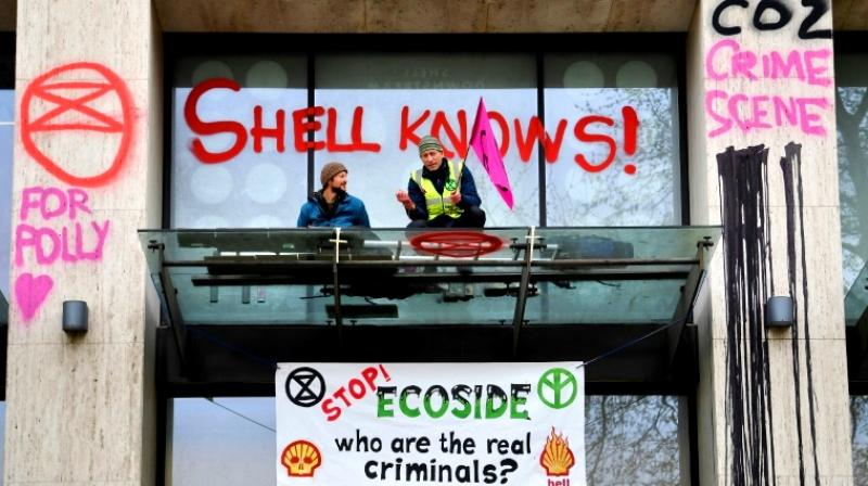 Campaigners daubed graffiti and smashed a window at the Shell Centre building. (Photo: AFP)