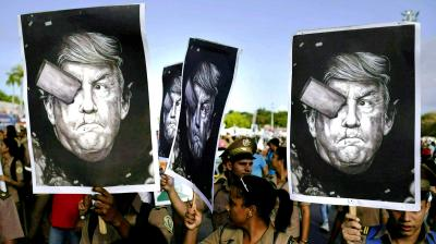 "Cuban soldiers carry depictions of President Donald Trump during the annual May Day parade held at Revolution Square in Havana, Cuba. Trump claimed via Twitter that if Cuban troops and militia do not cease their operations in support of Venezuela immediately, Cuba would suffer ""a full and complete embargo"" as well as ""highest-level sanctions."" (Photo: AP)"