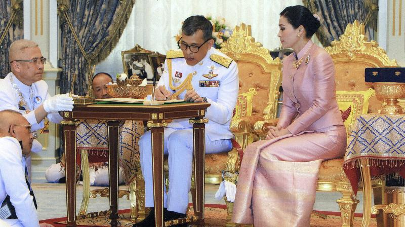 Thailand's King Maha Vajiralongkorn Bodindradebayavarangkun, with Queen Suthida Vajiralongkorn Na Ayudhya at Ampornsan Throne Hall in Bangkok. (Photo: AP)