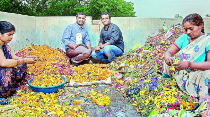 Ankit and Karan pose amidst flowers collected from temples.