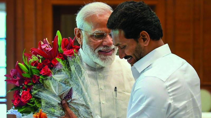 PM Narendra Modi is greated by YSR Congress chief and Andhra Pradesh chief minister-designate Y.S. Jagan Mohan Reddy in New Delhi on Sunday. (Photo: PTI)