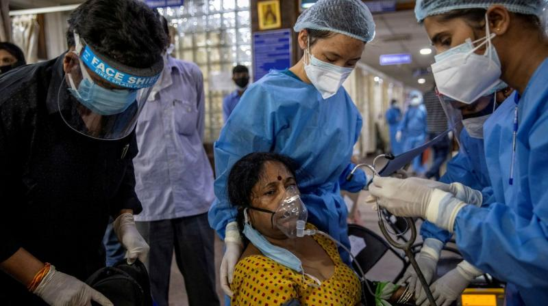 A patient suffering from the coronavirus receives treatment inside the emergency ward at Holy Family hospital in New Delhi. (Photo: Reuters)