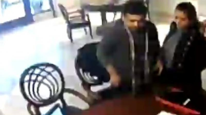 A video grab from the CCTV footage showing 'estranged wife of main accused Gautam Kundu and the investigating officer.
