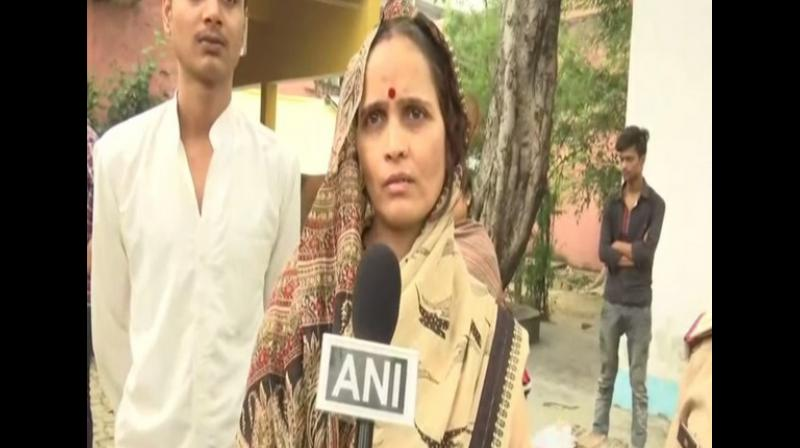 'We are going to meet Yogi Adityanath. The Chief Minister had given us time to meet at around 11 am today. The police are taking us there,' Tiwari's widow said. (Photo: ANI)