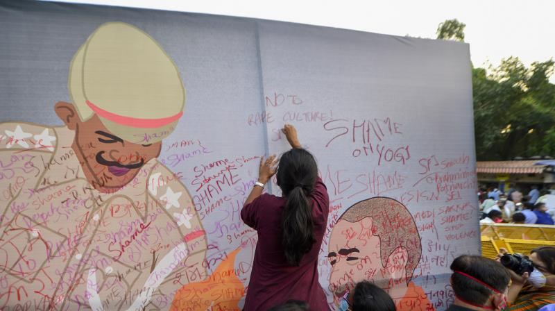 People from various organizations stage a protest against the alleged gang-rape of a 19-year-old Dalit woman in Uttar Pradesh's Hathras, at Jantar Mantar in New Delhi. PTI Photo