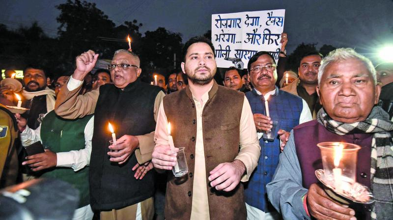 A file photo of Bihar grand alliance leaders being led by RJD leader Tejashwi Yadav in a candlelight march in Patna against the Janata Dal (United) government headed by chief minister Nitish Kumar.