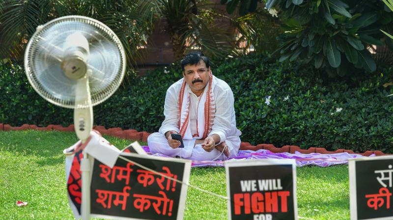 AAP MP Sanjay Singh stages a protest over his suspension from the remaining monsoon session of Parliament over the ruckus created in the Rajya Sabha. (PTI)