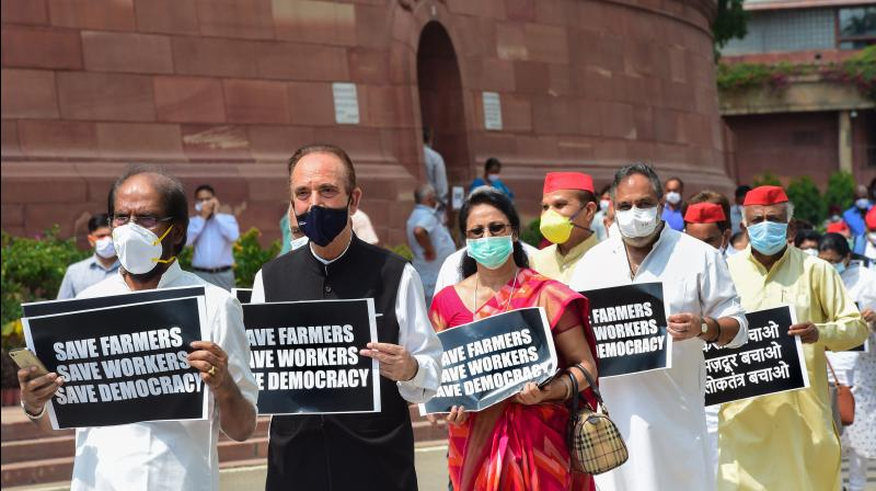 Senior Congress MP Ghulam Nabi Azad and other opposition lawmakers protest against the farm and labour bills at Parliament House in New Delhi. (PTI)