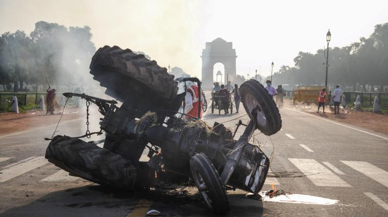 Charred remains of a tractor that was set on fire near India Gate during a protest against the new farm laws, in New Delhi, Monday, Sept 28, 2020. (PTI)