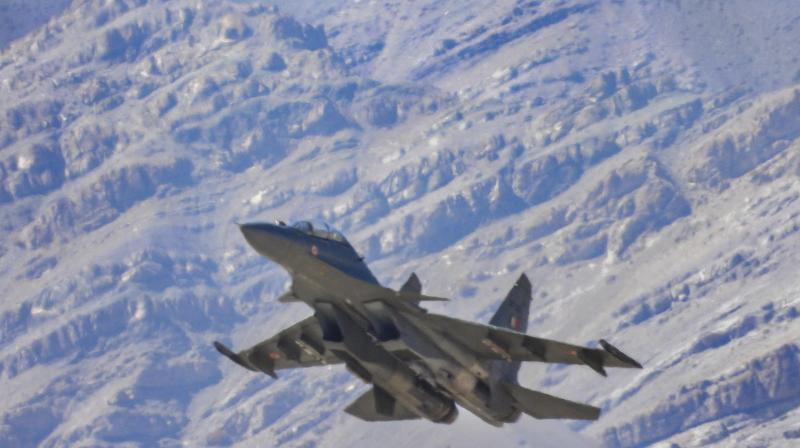 An IAF fighter jet flies against the backdrop of the Himalayan mountain range, amid the India-China stand off in eastern Ladakh, in Leh district.  (PTI)