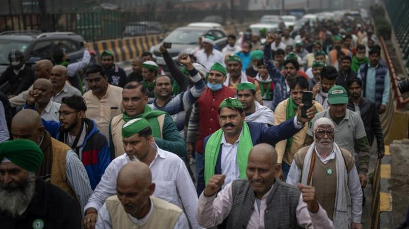 A group of protesting farmers march towards the residence of ruling Bhartiya Janata Party leader Mahesh Sharma to hand over a list of their demands during a protest against new farm in Noida on the outskirts of New Delhi, India, Saturday, Dec. 12, 2020. Indian farmers filed a petition with the Supreme Court on Friday seeking the quashing of three new laws on agricultural reform which they say will drive down crop prices, as they continued their two-week blockade of highways connecting to the Indian capital. (AP)