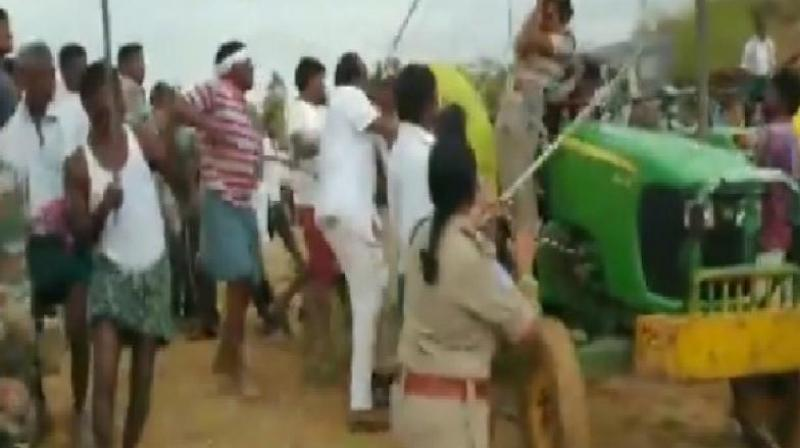 Videos showed the officer being accosted by a mob as she tried to get off a tractor. (Photo: ANI)