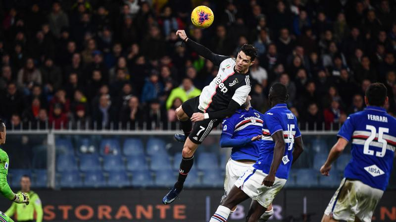 Cristiano Ronaldo's scoring streak continued as the Juventus forward netted a soaring header to secure a 2-1 victory at Sampdoria, putting the defending champion back atop the Serie A standings. (Photo: AFP)