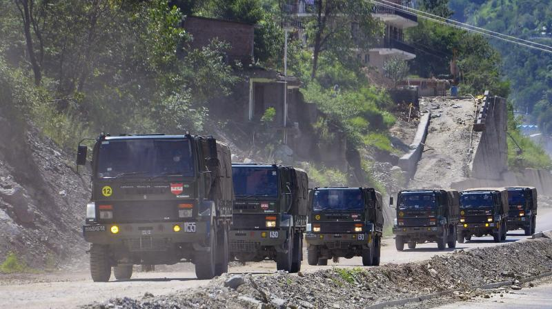 Army trucks move towards Ladakh via Leh–Manali Highway, in Manali. Chinese and Indian patrols regularly encounter one another along the disputed border, and both sides often accuse one another of border incursions, the report said.(PTI)