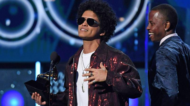 Bruno Mars with his award at the Grammys stage. (Photo: AFP)