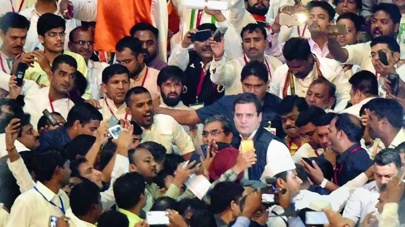 Rahul Gandhi with party workers at Indira Gandhi Stadium in New Delhi. (Photo: PTI)